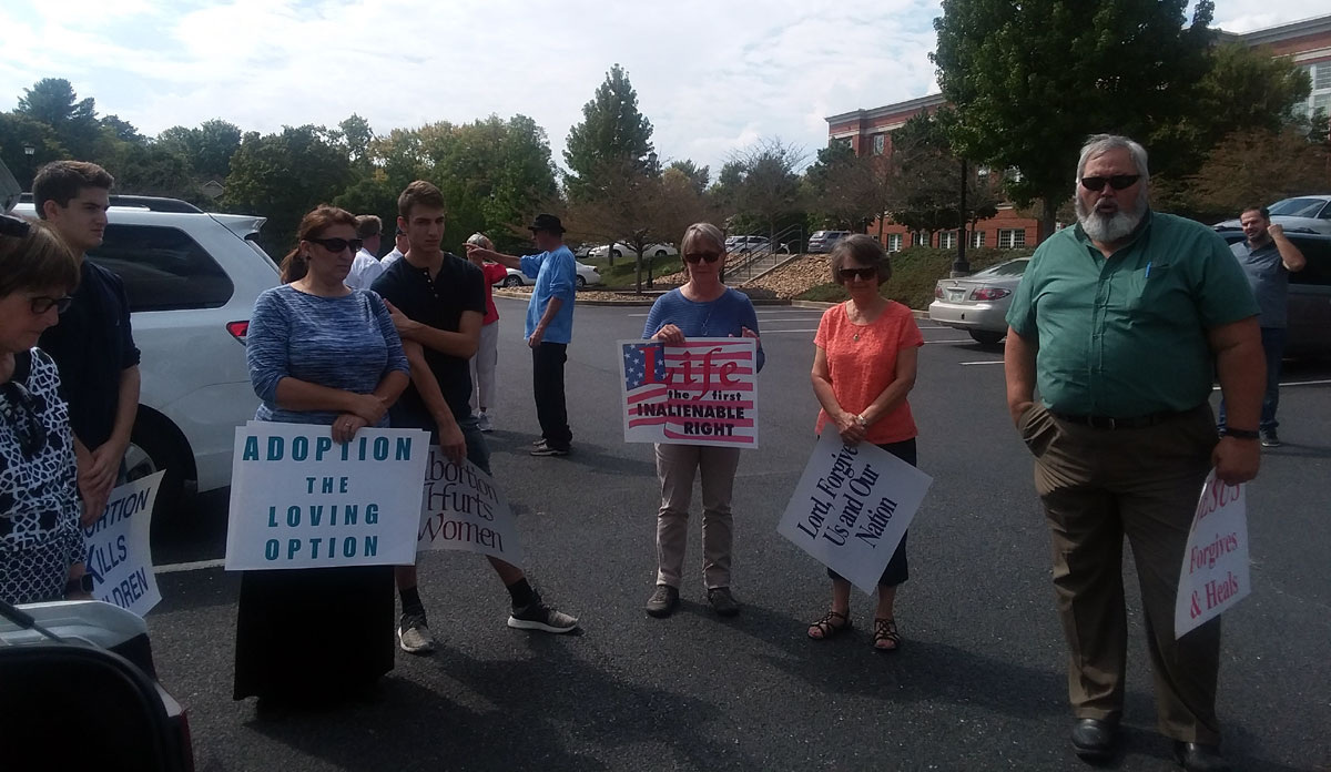 Members of Covenant Baptist Church standing with life chain signs